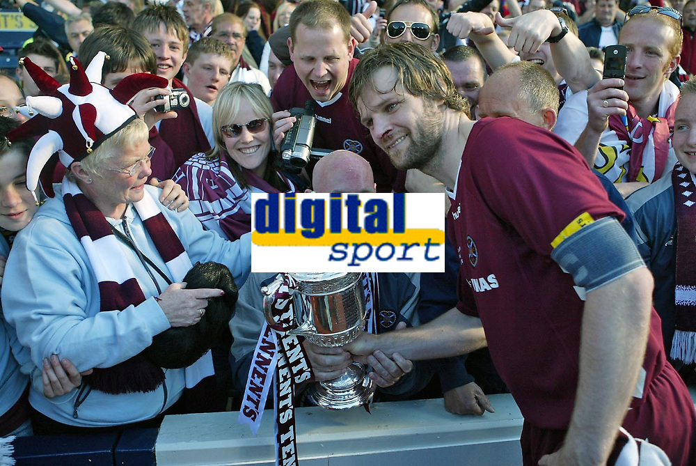 Photo: Andrew Unwin.<br /> Hearts v Gretna. Tennants Scottish Cup Final. 13/05/2006.<br /> Hearts' Steven Pressley (R) celebrates with the fans.