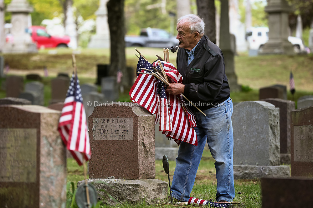 (5/16/15, FRAMINGHAM, MA) Cemetery trustee, John Silva, places flags on veterans' graves at Edgell Grove Cemetery in Framingham on Saturday. Daily News and Wicked Local Photo/Dan Holmes
