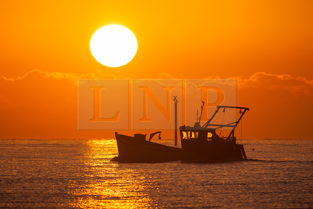 © Licensed to London News Pictures. 06/11/2017. Southsea, UK.  A fishing boat sails in The Solent as the sun rises into clear skies this morning, 6th November 2017. Photo credit: Rob Arnold/LNP