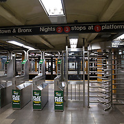 A subway station pay station is seen underground in New York City on Thursday, October 24, 2014. (AP Photo/Alex Menendez)