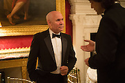 STEVE MCCURRY, Professor Mikhail Piotrovsky Director of the State Hermitage Museum, St. Petersburg and <br /> Inna Bazhenova Founder of In Artibus and the new owner of the Art Newspaper worldwide<br /> host THE HERMITAGE FOUNDATION GALA BANQUET<br /> GALA DINNER <br /> Spencer House, St. James's Place, London<br /> 15 April 2015