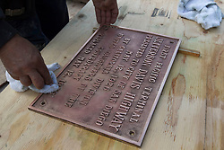 August 16, 2017 - San Diego, California, USA - (File Photo) -  A plaque honoring the President of the Confederacy Jefferson Davis was removed from Horton Plaza Park in downtown San Diego Wednesday morning. PICTURED: April 29 of 2016 - A worker at Horton Plaza polished a bronze plaque honoring Jefferson Davis, the president of the confederacy, that was being reinstalled in the tile walkway at the remodeled Horton Plaza, in preparation for the reopening of the Plaza. (Credit Image: © John Gibbins/San Diego Union-Tribune via ZUMA Wire)