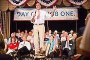 14 SEPTEMBER 2011 - SUN LAKES, AZ: Mitt Romney (CQ) stands on a chair to speak in a packed ballroom at the Oakwood Clubhouse at Sun Lakes Wednesday. Romney was one of the first of the 2012 Republicans running for the GOP Presidential nomination to come to Arizona. He campaigned Wednesday in Tucson and Sun Lakes and attended a private event in Tempe.    PHOTO BY JACK KURTZ