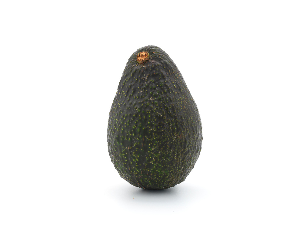 whole single avocado on a white background