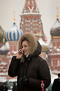 Moscow, Russia, 20/02/2005..A Russian woman speaking on a mobile telephone in a snowbound Red Square.