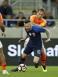 (L-R) Albert Rusnak of Slovakia, Ruud Vormer of Holland during  the International friendly match between Slovakia and The Netherlands at Stadium Antona Malatinskeho on May 31, 2018 in Trnava, Slovakia