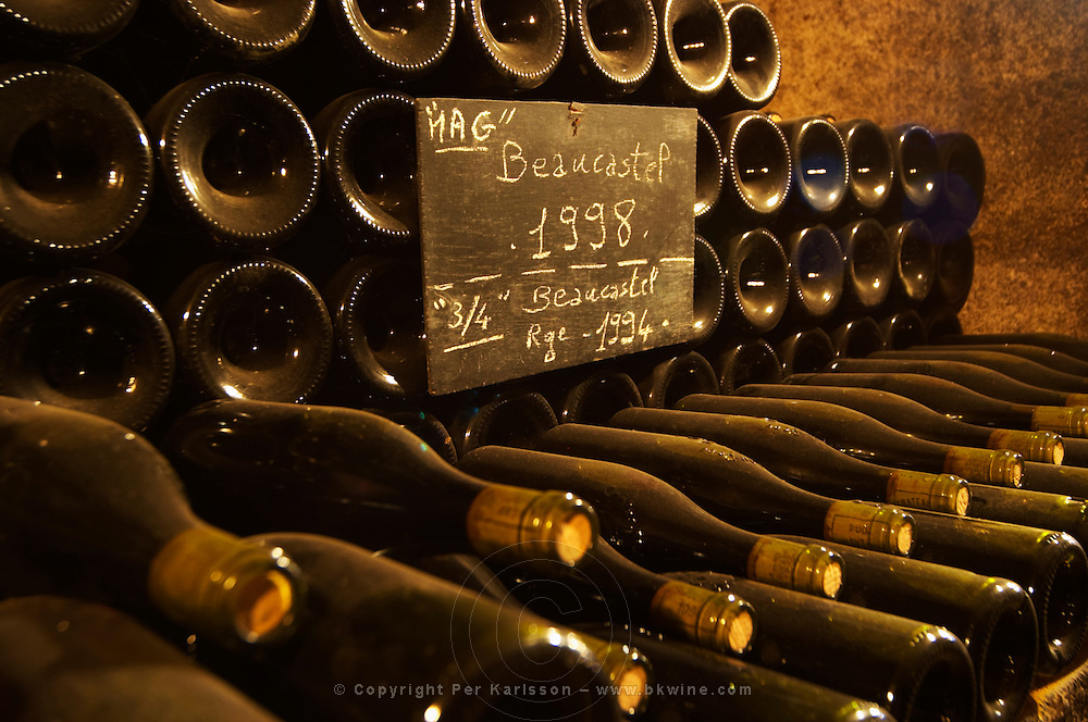 A big pile of magnum bottles of Beaucastel 1998 as well as regular bottles of 1994 written on a chalk board. Chateau de Beaucastel, Domaines Perrin, Courthézon Courthezon Vaucluse France Europe