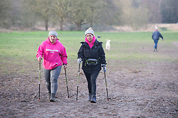 © Licensed to London News Pictures 20/02/2021.        Sidcup, UK. Two Nordic walkers out and about at Footscray Meadows in Sidcup, South East London this morning getting in some early morning exercise. Warmer temperatures are expected all weekend with today set to be the hottest in three months. Photo credit:Grant Falvey/LNP