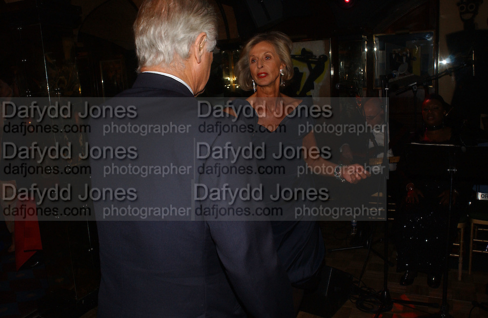 Baron and Baroness Lambert, Party given by Taki and Alexandra Theodorakopoulos. Annabels. London. 26 September 2006. -DO NOT ARCHIVE-© Copyright Photograph by Dafydd Jones 66 Stockwell Park Rd. London SW9 0DA Tel 020 7733 0108 www.dafjones.com