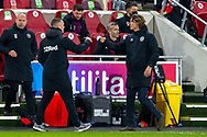 Derby County Interim manager Wayne Rooney fist-bumps with Brentford manager Thomas Frank after the EFL Sky Bet Championship match between Brentford and Derby County at Brentford Community Stadium, Brentford, England on 9 December 2020.