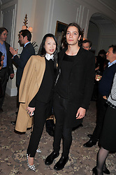 ROSEY CHAN and TOMAS AUKSAS at the launch of Whole World Water at The Savoy Hotel, London on 22nd March 2013.