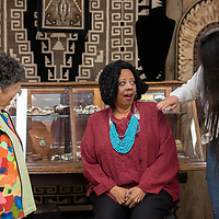 Travel writers Elaine Warner, left, and Renee Gordan, center, try on Native American jewlrey at the Tanner's Indian Arts on May 29th in downtown Gallup.