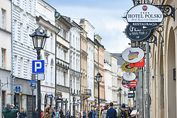 April 13, 2017 - Krakow, Poland - A view of some addvertising signs on Florianska Street in Krakow. Since the landscape urban law was introduced in Poland, the rules are more strict in relation to the size and placement of signs, boards and banners..On Thursday, April 13, 2017, in Krakow, Poland. (Credit Image: © Artur Widak/NurPhoto via ZUMA Press)