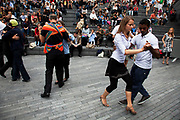 Couples of Tango dancers dance at The Scoop as part of The Thames Festival 2011. Many couples take to dancing at once in this mass group activity.