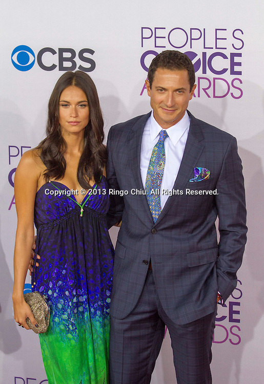 Sasha Roiz (R) arrives at the 39th Annual People's Choice Awards at Nokia Theatre L.A. Live on Wednesday January 9, 2013 in Los Angeles, California, United States. (Photo by Ringo Chiu/PHOTOFORMULA.com)