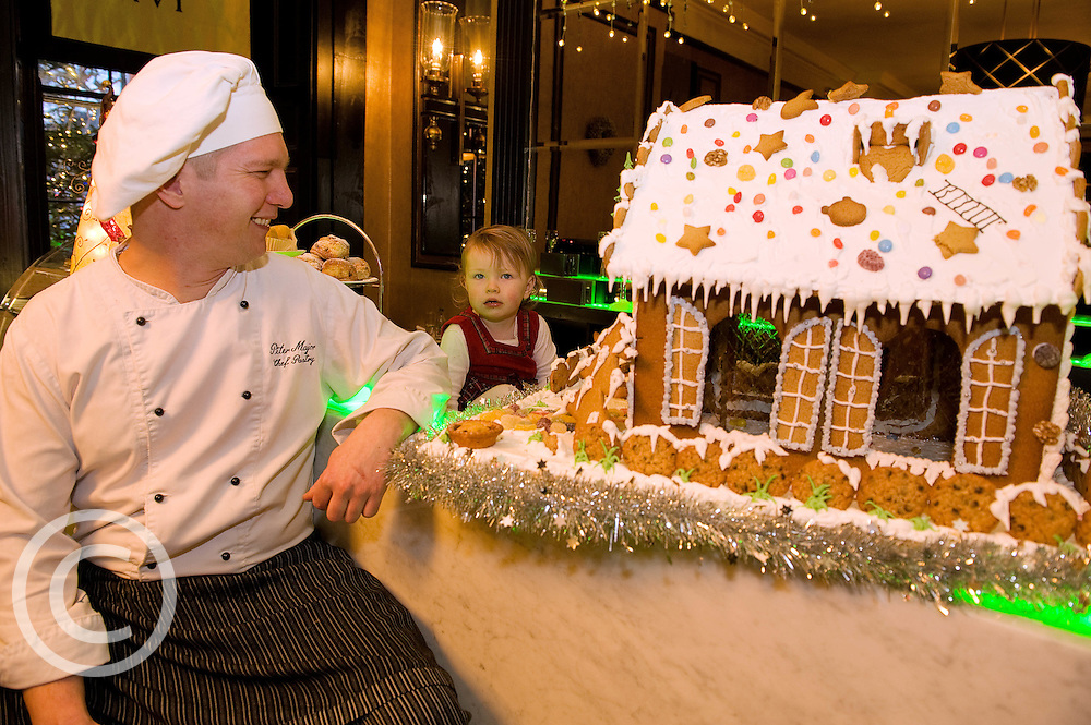 Jenny Mannion (1 1/2 years )  and chef Peter Major who designed  with a mouth - watering Gingerbread House, currently on display in the hotels elegant lobby that will be delivered to the hospital on Christmas Eve as a special delight for children & their families who regrettably have to spend the holiday season in hospital.  Photo:Andrew Downes