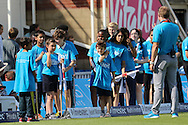 Children wearing Cricket United blue prepare to welcome the players onto the pitch during the third day of the 5th Investec Ashes Test match between England and Australia at The Oval, London, United Kingdom on 22 August 2015. Photo by Ellie Hoad.