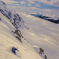 A skier plunges through powder snow on an off-piste chute at Araphoe Basin, Colarado.