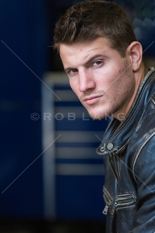 rugged good looking man in a leather jacket and black tee shirt