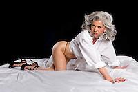 Very attractive mature woman playfull in her beedroom
