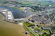 Nederland, Groningen, Delfzijl, 05-08-2014; haven Delfzijl met droogdokken en jachthaven Neptunus. Gezien naar Zeehavenkanaal, links de  Eems, stadscentrum en Eemskanaal midden rechts, Eemshotel in de voorgrond.<br /> Delfzijl harbor with docks and marina Neptune. <br /> luchtfoto (toeslag op standard tarieven);<br /> aerial photo (additional fee required);<br /> copyright foto/photo Siebe Swart