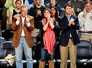 CHARLOTTESVILLE, VA- NOVEMBER 29: From left. Author John Grisham watches the game with his wife Renee and son Ty during the game on November 29, 2011 at the John Paul Jones Arena in Charlottesville, Virginia. Virginia defeated Michigan 70-58. (Photo by Andrew Shurtleff/Getty Images) *** Local Caption *** John Grisham