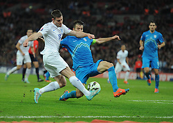 Bostjan Cesar of Slovenia blocks a cross from James Milner of England (Manchester City) - Photo mandatory by-line: Alex James/JMP - Mobile: 07966 386802 - 15/11/2014 - SPORT - Football - London - Wembley - England v Slovenia - EURO 2016 Qualifier