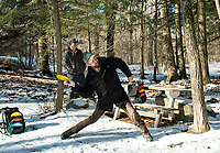 Eric Benevides looks on as Scott Jarvis takes his first drive from the 5th Tee at the Chris Daigle Memorial Disc Golf Course in Bolduc Park Friday afternoon.  (Karen Bobotas Photo/for The Laconia Daily Sun)