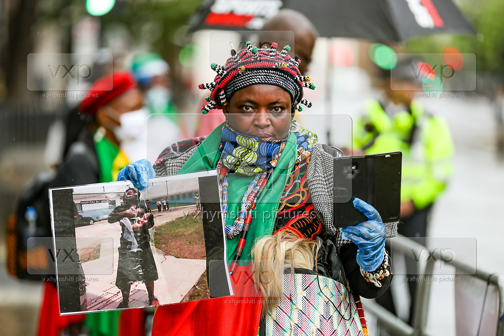 """Dozens of British-Cameroon political activists are protesting in Whitehall, nearby Downing Street prior to French President Emanuel Macron's visit in London, on Thursday, June 18, 2020. They say France is involved in the looting of Cameroon and Africa. A letter addressing the press and members of the public says: """"We are here to tell Mr Macron this is unacceptable. Enough is enough!"""".<br /> For his first foreign trip since lockdown, Emmanuel Macron will be in London to mark the 80th anniversary of de Gaulle's « appel de Londres », as well as cement Franco-UK ties at a strained time due to Brexit. (Photo/ Vudi Xhymshiti)"""