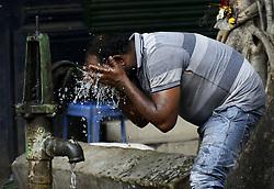 April 28, 2019 - Kolkata, India - A man washes his face to beat the heat in Kolkata, India as the city face maximum 38 degree Celsius and minimum 29 degree Celsius without rainfall to IMD (Indian meteorolgical Department), Kolkata  (Credit Image: © Indranil Aditya/NurPhoto via ZUMA Press)