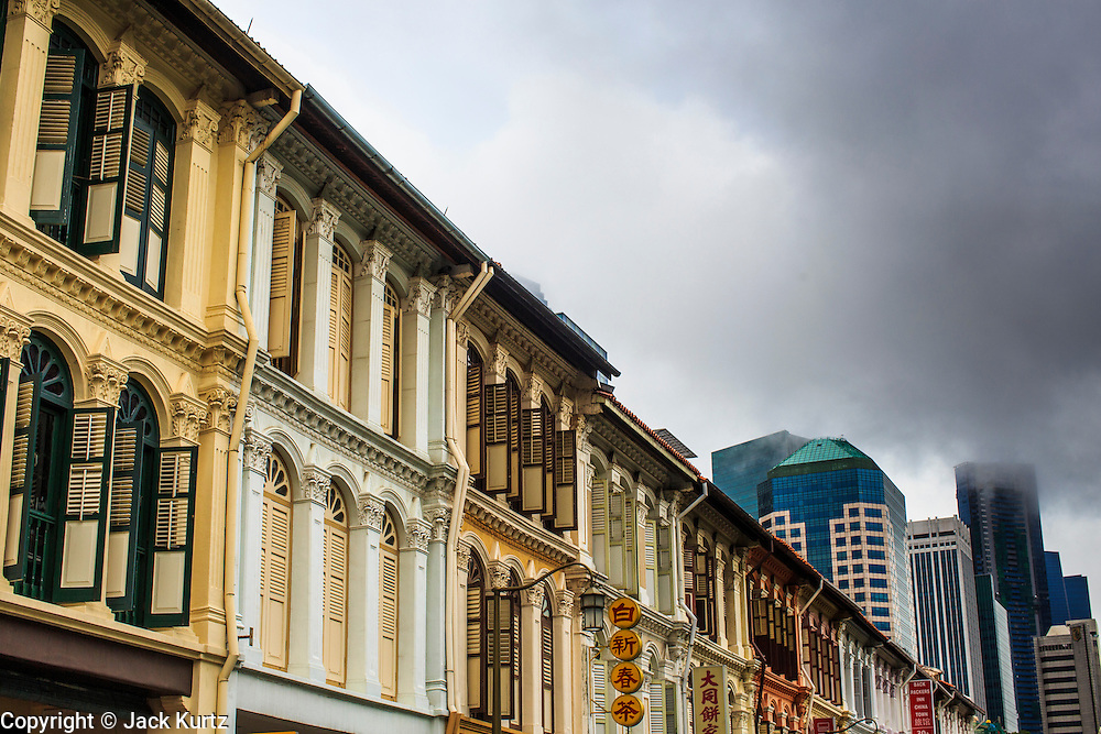 18 DECEMBER 2012 - SINGAPORE, SINGAPORE: Storm clouds roll into Singapore over the traditional shophouses along Mosque Street in Singapore.   PHOTO BY JACK KURTZ
