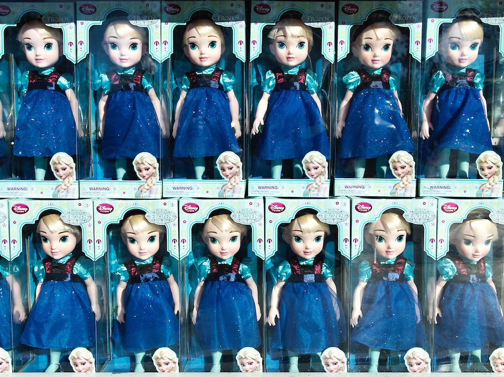 Packaged Disney Frozen doll in storefront window.