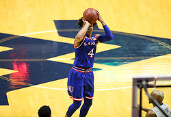 Jan 15, 2018; Morgantown, WV, USA; Kansas Jayhawks guard Devonte' Graham (4) shoots a three pointer during the first half against the West Virginia Mountaineers at WVU Coliseum. Mandatory Credit: Ben Queen-USA TODAY Sports