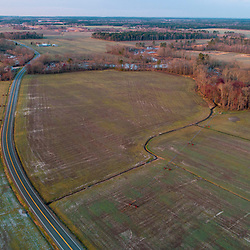 Drone view of fields, forests, Maryland Route 335 in Church Creek, Maryland. Spring.
