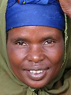 Rwanda- A woman smiles in the Southern Province, Rwanda.