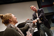 John Dickerson signs an autograph at Grinnell College for the taping of Slate's Political Gabfest on December 7, 2011.