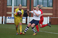 Preston Striker Jasmine Swarbrick challenges Blackburn Keeper Danielle Hill during the FA Women's Lancashire Cup Final match between Preston North End Ladies and Blackburn Rovers Women at the County Ground, Leyland, United Kingdom on 28 April 2016. Photo by Pete Burns.