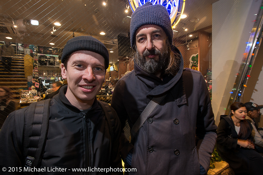 Maximilian Funk of Gestalen Publishers with photographer Hermann Köpf at the Mooneyes Yokohama Hot Rod & Custom Show after-party at Mooneyes headquarters. Yokohama, Japan. December 7, 2015.  Photography ©2015 Michael Lichter.