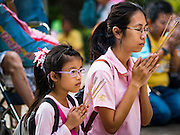 13 OCTOBER 2016 - BANGKOK, THAILAND: A mother and her daughter pray for Bhumibol Adulyadej, the King of Thailand, at Siriraj Hospital Thursday morning before the King's death was announced. Thousands of people came to the hospital to pray for the beloved monarch. Bhumibol Adulyadej, the King of Thailand, died at Siriraj Hospital in Bangkok Wednesday, October 13, 2016. Bhumibol Adulyadej, 5 December 1927 – 13 October 2016, was the ninth monarch of Thailand from the Chakri Dynasty and is known as Rama IX. He became King on June 9, 1946 and served as King of Thailand for 70 years, 126 days. He was, at the time of his death, the world's longest-serving head of state and the longest-reigning monarch in Thai history.       PHOTO BY JACK KURTZ
