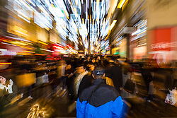 London, December 24 2017. Crowds grow in London's west end on Christmas eve as last minute shoppers hunt for gifts. PICTURED: A tide of shoppers swarms along Oxford Street in the hope of getting all their shopping done in time. © SWNS