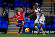 Craig Westcarr of Walsall shoots past Tranmere Rovers Stephen Arthurworrey. Skybet football league 1 match, Tranmere Rovers v Walsall at Prenton Park in Birkenhead, England on Saturday 11th Jan 2014.<br /> pic by Chris Stading, Andrew Orchard sports photography.