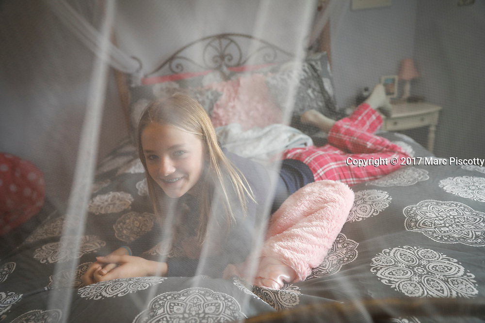 SHOT 12/25/17 11:01:08 AM - Alyssa O'Connell, 13, of Albuquerque, N.M. relaxes on her bed in her room at the family's home in Albuquerque, N.M. (Photo by Marc Piscotty / © 2017)