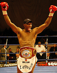 Johnny Nelson celebrates as he wins a split decision on the three judges cards, drawing in the fight with Guillermo Jones from Panama but retaining his title as he was the defending champion at the end of their WBO Cruiserweight Championship bout at the Storm Arena.