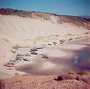 1212-03. cars parked on Cape Kiwanda beach
