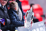 A homemade FA Cup is held by a young Doncaster fan during the The FA Cup fourth round match between Doncaster Rovers and Oldham Athletic at the Keepmoat Stadium, Doncaster, England on 26 January 2019.
