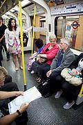 London Underground Circle Line tube train passengers.
