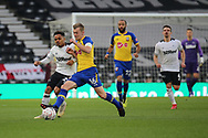 Southampton midfielder James Ward-Prowse and Derby County midfielder Duane Holmes challenge for the ball during the The FA Cup 3rd round match between Derby County and Southampton at the Pride Park, Derby, England on 5 January 2019.