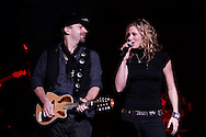 Tribune Photo/SANTIAGO FLORES Kristian Bush and Jennifer Nettles of Sugarland perform at The Morris Performing Arts Center on Friday night.