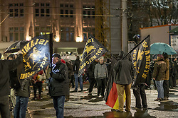 """11.01.2016, Innenstadt Leipzig, Leipzig, GER, Kundgebung der Legida zum ersten Jahrestag, im Bild Anhaenger der Legida mit Fahnen """"Islamists not welcome"""" bei der Kundgebung der Legida zum ersten Jahrestag // demonstration of Leipzig' s Europeans against the Islamization of the West (LEGIDA), a group linked with the PEGIDA movement, in Innenstadt Leipzig in Leipzig, Germany on 2016/01/11. EXPA Pictures © 2016, PhotoCredit: EXPA/ Eibner-Pressefoto/ Hommes<br /> <br /> *****ATTENTION - OUT of GER*****"""