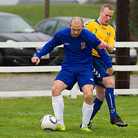 Clare's Garry Higgins keeps possesion of the ball from Roscommon's Shane Duffy